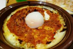 Doria (baked rice) with meat sauce and soft boiled egg