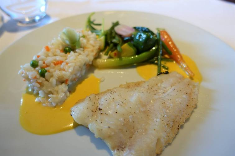 Roasted fish seared on one side, Chardonnay risotto, carrots and peas