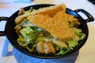 Classic Caesar salad with romaine lettuce, croutons, marinated anchovies, parmesan tuile and shavings