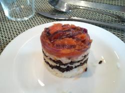 Vegetarian Rice stack with tomatoes, onions, black and white rice